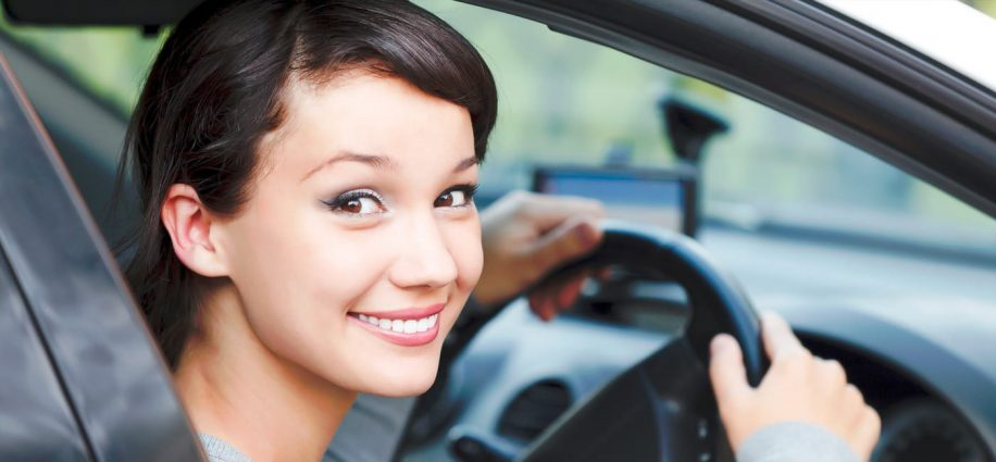 girl in car smiling